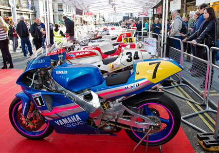 gp: LONDON - NOVEMBER 1: A vintage Moto GP motorcycle is put on public display as part of the Veteran GP riders Legends feature at the annual Regent street motor show on November 1, 2014 in London Editorial