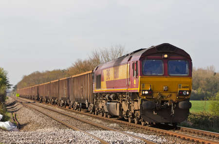 diesel locomotives: PIRTON, UK - APRIL 16: An EWS operated freight train takes a spoil load towards the south of Wales on April 16, 2014 in Pirton. EWS now owned by DB Schenker is the largest UK rail freight operator