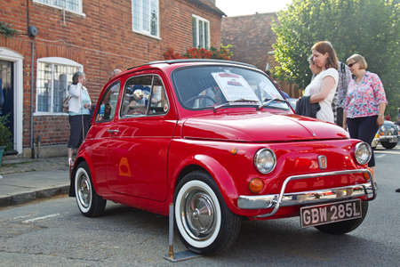 turned out: AMERSHAM, UK - SEPTEMBER 7: An immaculately turned out classic Fiat 500 motorcar stands on public display at the annual Amersham Heritage Day show on September 7, 2014 in Amersham.