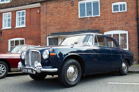 motorcar: AMERSHAM, UK - SEPTEMBER 7: An iconic vintage Rover 3.5L motorcar is lined up on the High Street alongside other classic vehicles at the annual Amersham Heritage show on September 7, 2014 in Amersham Editorial
