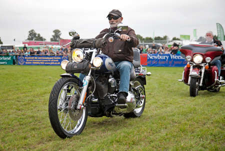 harley davidson motorcycle: NEWBURY, UK - SEPTEMBER 21: Members of a local Oxfordshire Harley Davidson motorcycle owners club parade around the main arena for the public at the Berks County show on September 21, 2013 in Newbury. Editorial