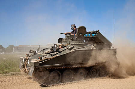 british army: WESTERNHANGER, UK - JULY 19: An ex British army Striker tank painted in European camouflage is driven at speed around the main arena at the War  Peace show on July 19, 2013 in Westernhanger