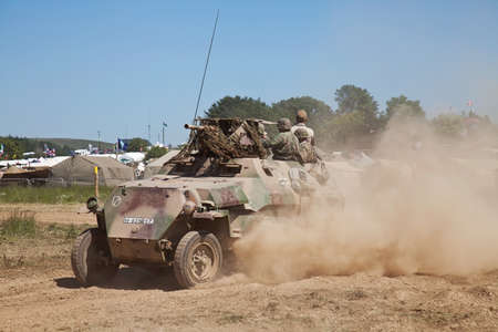 armoured: WESTERNHANGER, UK - JULY 19: An ex WW2 German army Hanomag armoured troop carrier gives a high speed display to the watching public at the War and Peace show on July 19, 2013 in Westernhanger