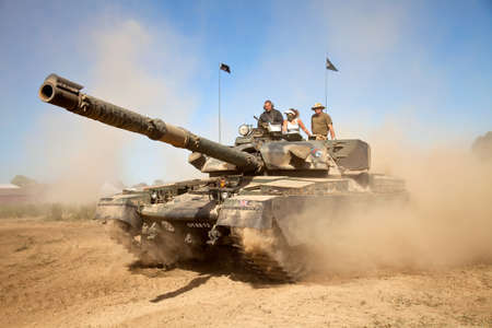 chieftain: WESTERNHANGER, UK - JULY 19: An ex British army Chieftain MBT tank is driven around the main arena for the public to watch at the WP show on July 19, 2013 in Westernhanger