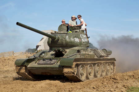 t34: WESTERNHANGER, UK - JULY 18: An ex Russian army WW2 T34 main battle tank is driven around the main arena for the public to watch at the WP show on July 18, 2014 in Westernhanger