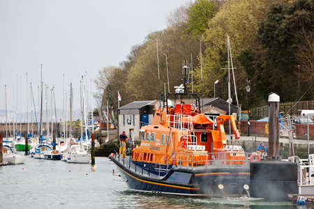 outs: WEYMOUTH, UK - APRIL 17: The crew of the Weymouth lifeboat leave the harbour to attend a potential emergency at sea on April 17, 2015 in Weymouth. Weymouth RNLI responds to around 100 call outs p.a