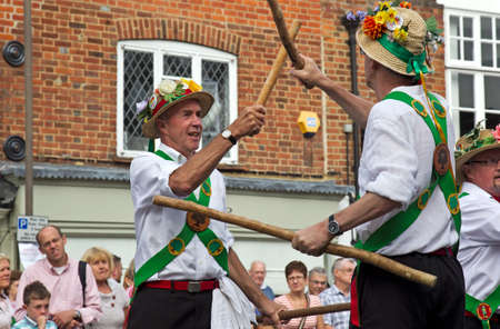folk heritage: AMERSHAM, UK - SEPTEMBER 7: As part of the entertainment at the annual Amersham Heritage day event Morris dancers demonstrate old English folk dancing to the public on September 7, 2014 in Amersham Editorial