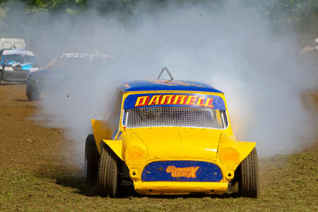 exits: STROUD, UK - MAY 3: An unnamed driver competing in Rd1 of the 2014 UKAC autograss series exits the race having blown the engine of his class 3 vehicle during a heat race on May 3, 2014 in Stroud