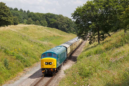 loco: TODINGTON, UK - JULY 25: A preserved ex British Railways class 45 diesel locomotive takes passengers on pleasure trips during the GWSR summer diesel gala on July 25, 2014 in Todington Editorial