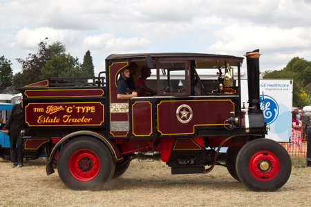steam traction: POTTEN END, UK - JULY 27: A preserved vintage steam lorry gives a display to the public in the main show arena at the Dacorum Steam Fair on July 27, 2014 in Potten End