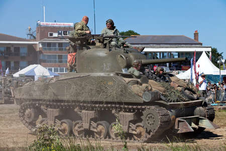 infantryman: WESTERNHANGER, UK - JULY 19: A WW2 Sherman tank leaves the main arena having just participated in a battle re-enactment for the public at the War  Peace show on July 19, 2013 in Westernhanger