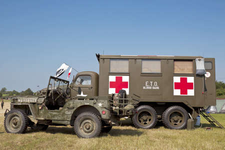 medical field: WESTERNHANGER, UK - JULY 18: An ex WW2 Jeep and mobile medical field truck are parked on static display for the public to view at the WP show on July 18, 2013 in Westernhanger