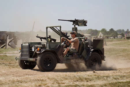 recon: WESTERNHANGER, UK - JULY 18: A modified heavily armoured light recon jeep gives a high speed demonstration in the main arena at the War  Peace show on July 18, 2013 in Westernhanger