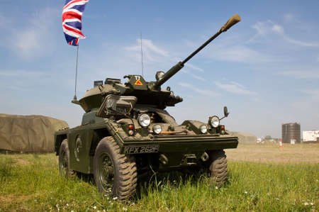 british army: WESTERNHANGER, UK - JULY 17: An ex British army Alvis Fox armoured car stands on static display at the War  Peace show on July 17, 2013 in Westernhanger