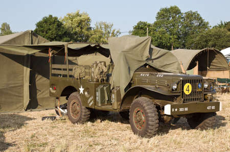 ww2: WESTERNHANGER, UK - JULY 18: A WW2 Dodge weapons carrier stands on static display for the public to view on one of the many out fields at the War  Peace show on July 18, 2013 in Westernhanger