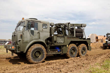 british army: WESTERNHANGER, UK - JULY 19: An ex British army recovery truck gives a display with other heavy trucks in the arena for the public to view at the War  Peace show on July 19, 2014 in Westernhanger