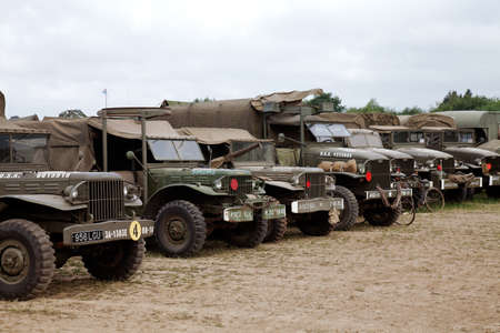 ww2: WESTERNHANGER, UK - JULY 20: WW2 allied GS trucks are parked on the outskirts of the arena for the public to view at the War  Peace show on July 20, 2013 in Westernhanger