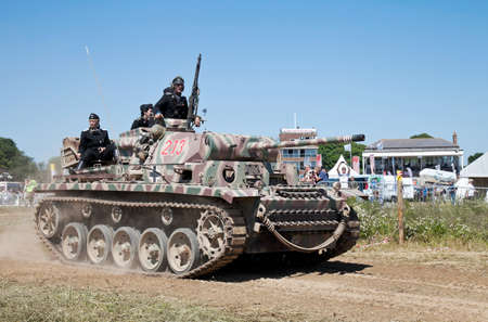 Panzer: WESTERNHANGER, UK - JULY 19: A replica WW2 Panzer tank leaves the main show arena having taken part in a mock battle for the public to view at the War  Peace show on July 19, 2013 in Westernhanger
