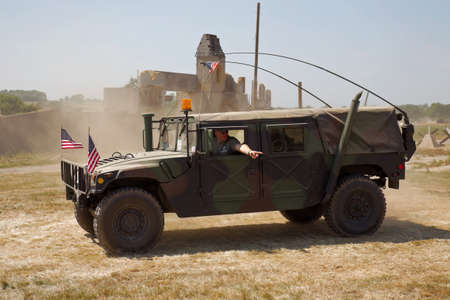 troop: WESTERNHANGER, UK - JULY 18: An ex US army Hummer troop carrier is driven around the main arena for the public to view at the WP show on July 18, 2013 in Westernhanger