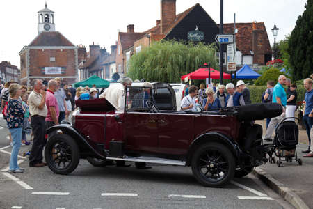 motorcar: AMERSHAM, UK - SEPTEMBER 7: A vintage motorcar is parked on the High Street as a static display for the public to view as part of the Amersham Heritage day festival on September 7, 2014 in Amersham