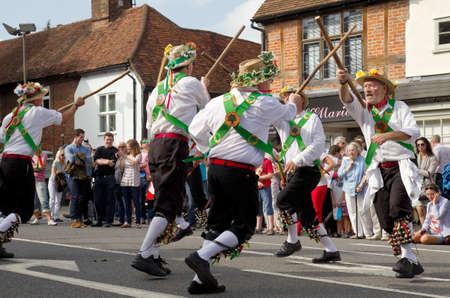 morris: AMERSHAM, UK - SEPTEMBER 7: As part of the entertainment at the annual Amersham Heritage day event Morris dancers demonstrate old English folk dancing to the public on September 7, 2014 in Amersham Editorial