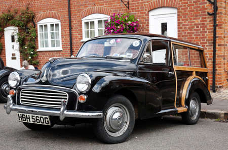 morris: AMERSHAM, UK - SEPTEMBER 13: A vintage Morris Traveller station wagon is parked on the side of the highway as a static display at the Amersham Heritage Day festival on September 13, 2015 in Amersham. Editorial