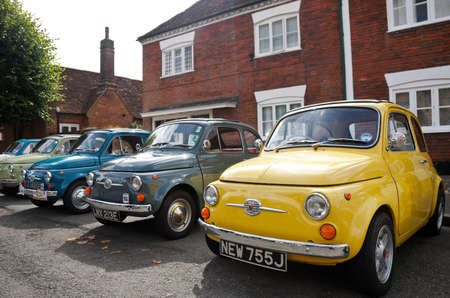 motorcars: AMERSHAM, UK - SEPTEMBER 13: A line-up of old and new iconic Fiat 500 motorcars are placed on public display at the Amersham Heritage Day festival on September 13, 2015 in Amersham. Editorial