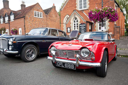 motorcar: AMERSHAM, UK - SEPTEMBER 13: A vintage Triumph TR4 sportscar is parked on the side of the public highway as a static display at the Amersham Heritage Day festival on September 13, 2015 in Amersham.