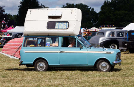 motorcar: POTTEN END, UK - JULY 27: A veteran Vauxhall Viva camper van with fold away roof is driven around the arena for the public to view at the Dacorum Steam  Country fair on July 27, 2014 in Potten End