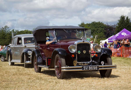 exits: POTTEN END, UK - JULY 27: A vintage Nash motorcar exits the show arena having just given a public display at the Dacorum Steam Fair on July 27, 2014 in Potten End. Editorial