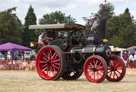 traction: POTTEN END, UK - JULY 27: A large industrial steam traction engine gives a display around the main show arena to members of the public at the Dacorum Steam fair on July 27, 2014 in Potten End