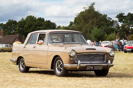motorcar: POTTEN END, UK - JULY 27: A 1966 A110 Austin Westminster saloon car heads toward the main display area at the Dacorum Steam fair on July 27, 2014 in Potten End