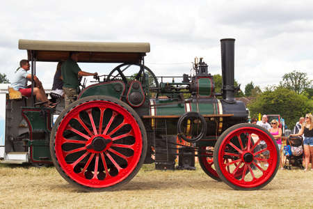 steam traction: POTTEN END, UK - JULY 27: A large industrial steam traction engine gives a display around the main show arena to members of the public at the Dacorum Steam fair on July 27, 2014 in Potten End