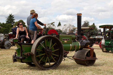 traction: POTTEN END, UK - JULY 27: A large vintage traction engine leaves the parade grounds heading toward the vehicle preparation area at the Dacorum Steam fair on July 27, 2014 in Potten End