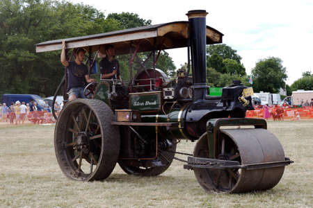 steam traction: POTTEN END, UK - JULY 27: A large vintage road roller gives a display to the public around the main display arena at the Dacorum Steam fair on July 27, 2014 in Potten End