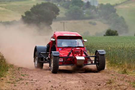 brit: WULSTAN, UK - JULY 21: An unnamed driver approaches the top of the final hill climb before heading to the finish line during the AWDC UK Brit Part Comp Safari competition on July 21, 2013 in Wulstan.
