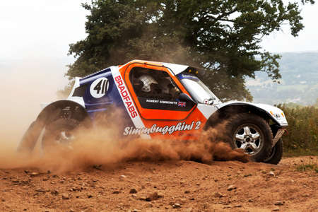 brit: WULSTAN, UK - JULY 21: An unnamed driver exits the last corner on the course before heading toward the finish line during the AWDC UK Brit Part Comp Safari competition on July 21, 2013 in Wulstan.