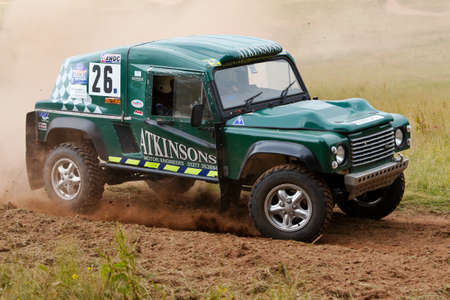 unnamed: WULSTAN, UK - JULY 21: An unnamed driver reaches the outer limit of the course before turning back into the wood sections during the AWDC UK Brit Part Comp Safari competition on July 21, 2013 in Wulstan.