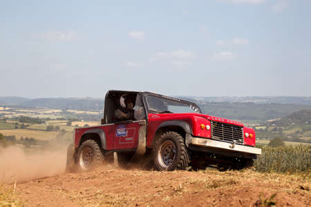 brit: WULSTAN, UK - JULY 21: An unnamed driver reaches the top of the final hill climb before turning toward the finish line during the AWDC UK Brit Part Comp Safari competition on July 21, 2013 in Wulstan.