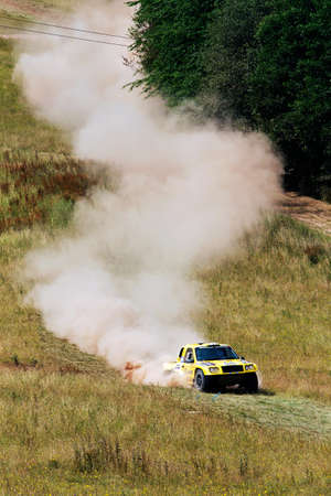 comp: WULSTAN, UK - JULY 21: An unnamed driver speeds over open ground towards a wooded section of the course during the AWDC UK Brit Part Comp Safari competition on July 21, 2013 in Wulstan. Editorial