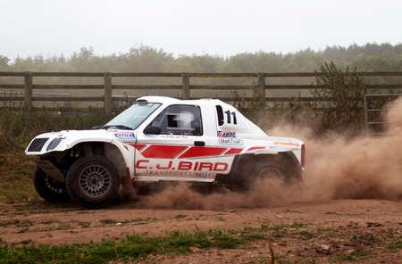 motorcar: WULSTAN, UK - JULY 21: An unnamed driver negotiates the gated field exit section at speed during the AWDC UK Brit Part Comp Safari competition on July 21, 2013 in Wulstan.