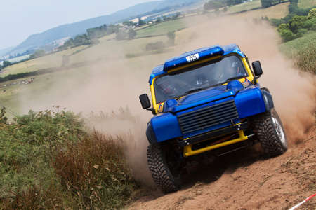 motorcar: WULSTAN, UK - JULY 21: An unnamed driver turns in to take the final field gate before heading toward the finish line during the AWDC UK Brit Part Comp Safari competition on July 21, 2013 in Wulstan. Editorial