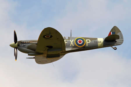 aerodrome: STANDEN, UK - AUGUST 15: A vintage WW2 Spitfire exits the flight line having passed over Headcorn aerodrome during the Combined Ops military show on August 15, 2015 in Standen