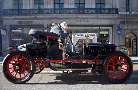motorcars: LONDON - NOVEMBER 3: One of the many veteran motorcars due to take part in the annual London to Brighton race enters Regents street very early in the morning on November 3, 2012 in London.