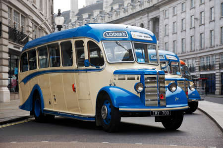 london to brighton: LONDON - OCTOBER 31: A vintage bus due to take part in a charity run to Brighton is stood on public display at the annual Regents Street classic car show on October 31, 2015 in London.