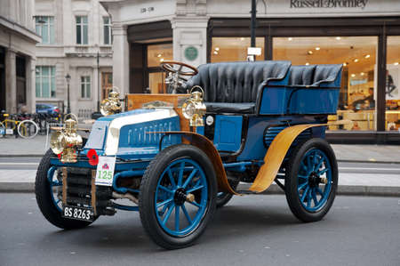 london to brighton veteran car run: LONDON - OCTOBER 31: A veteran motorcar due to take part in the annual London to Brighton run is stood on public display at the Regents Street classic car show on October 31, 2015 in London. Editorial
