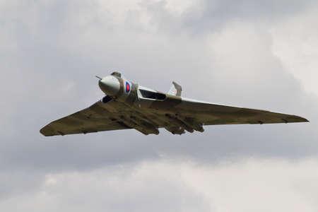 aerodrome: HEADCORN, UK - AUGUST 15: A vintage Avro Vulcan bomber passes down the flight line at Headcorn aerodrome for the public to watch on August 15, 2015 in Headcorn