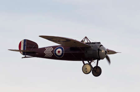 monoplane: KINGSHILL, UK - OCTOBER 5: A vintage WW1 Bristol monoplane fighter aircraft gives a low level pass by before flying back to base, at the Old Warden aerodrome on October 5, 2014 in Kingshill