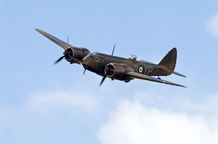 aerodrome: KINGSHILL, UK - JULY 5: A vintage WW2 Bristol Blenheim bomber aircraft gives a low past before flying back to base, at the Old Warden aerodrome on July 5, 2015 in Kingshill Editorial