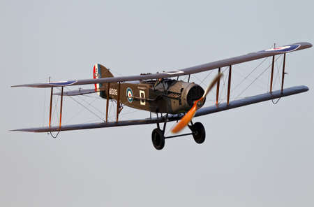 ww1: NORTHILL, UK - JULY 6: A vintage Bristol F2b fighter bomber from WW1 gives an aerial display to the watching public at an airshow over Old Warden aerodrome on July 6, 2013 in Northill